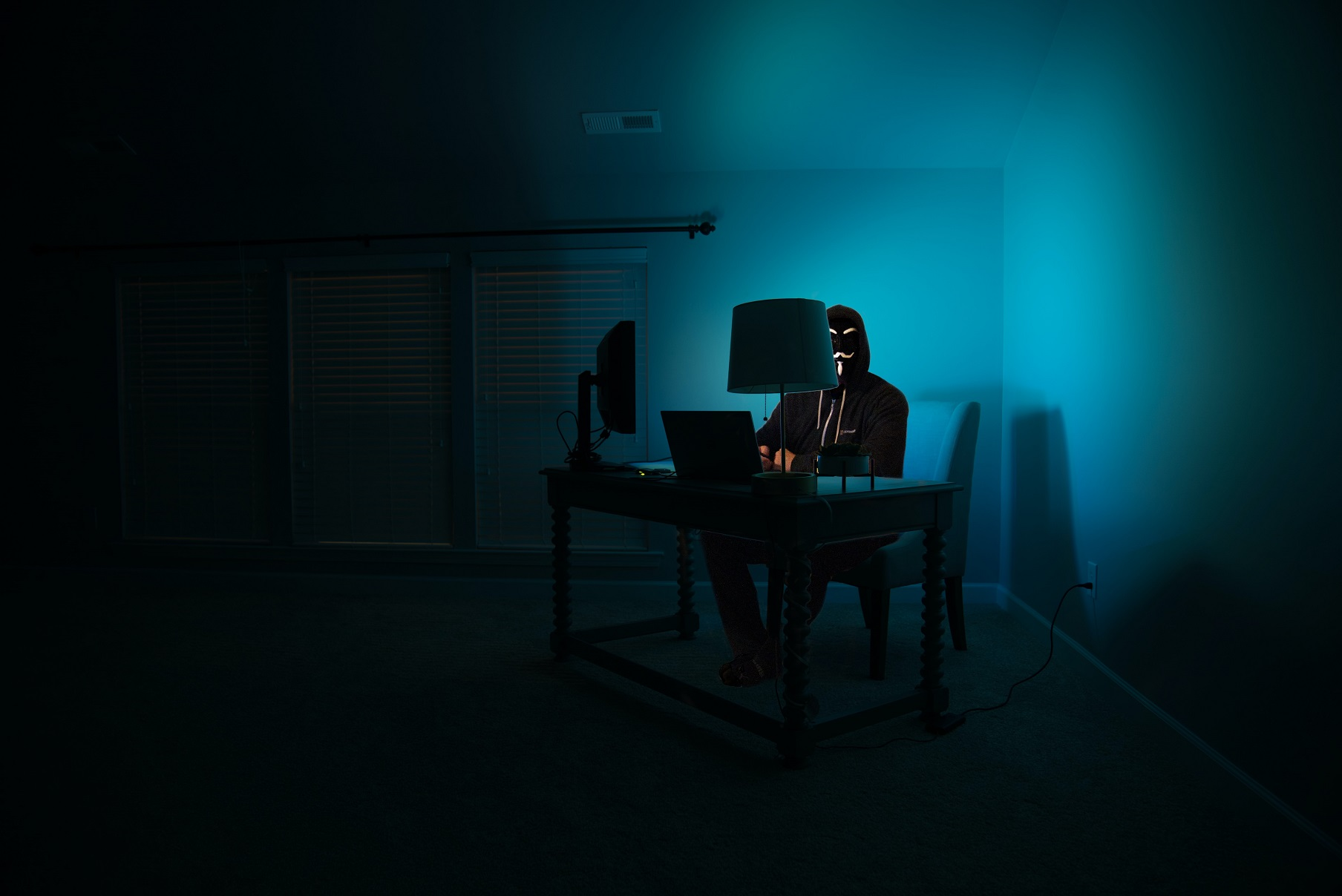 Ransomware Attacks, a cybercriminal in front of a computer
